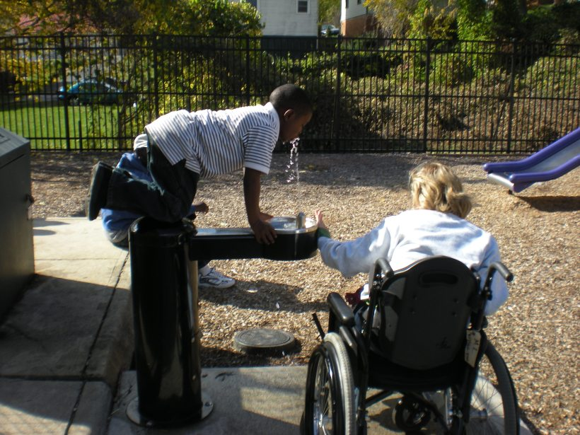 In this picture Maureen is helping Xavier drink from the complected water fountain at College Hill. The kids love Maureen and she always makes them smile. The boys love to help her and the rest of us out by pushing her in the wheelchair up the steep hills of the area.