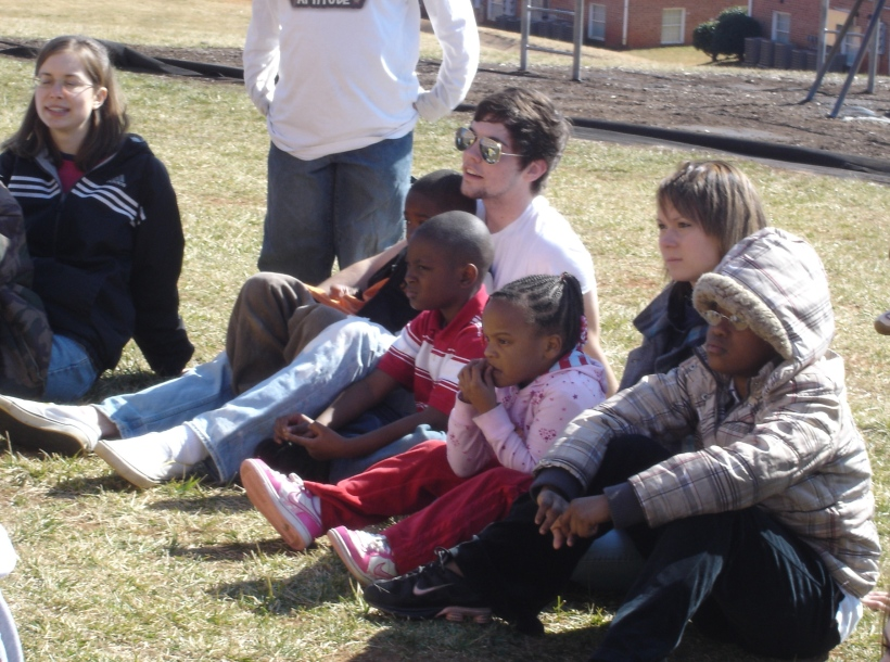 I just think that these show how much Campus Serve is about love.  We love these kids and form such bonds with them that we hold them close and they beg to sit on our laps.  It also expresses the love involved in Campus Serve because we offer lessons about God to them because we love them so much that we don't want them to miss out on the truth about God and Jesus.  We love them and we want them to know that God loves them.