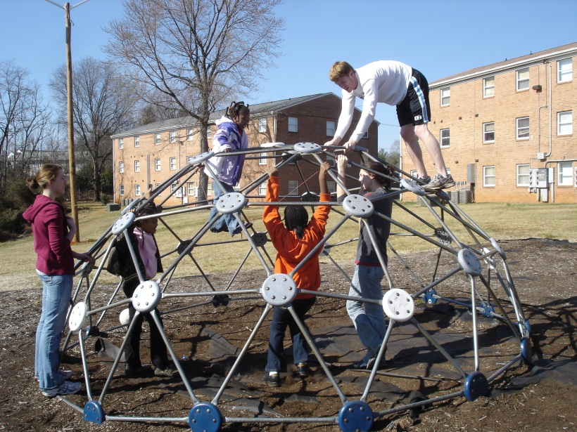 The one with all of the kids on the jungle gym with the college kids just shows that we are involved with the kids.  We don't just watch them.  Campus Serve is about getting involved, not caring if you get dirty, not caring about what people think, just loving the kids enough to play with them in whatever way.  Campus Serve is also a way for you to connect back to your childhood by just getting to play.  I think it is important for us not to forget what it is like to be kids, especially because we are called to have the faith of a child.