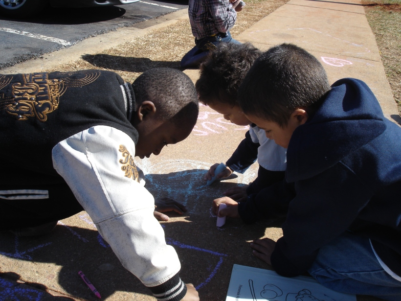 The one of the three boys drawing together with chalk shows that Campus Serve is about relationships.  It is not just about us forming relationships with the kids and the families, but about the kids building friendships with each other.  We act as mentors to the kids and help them to learn to love and respect each other.